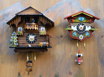Traditional colorful wooden cuckoo clocks Royalty Free Stock Image