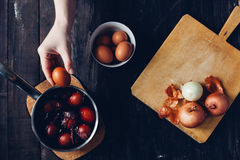 Traditional coloring Easter eggs with onion. Happy Easter Royalty Free Stock Images
