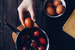 Traditional coloring Easter eggs with onion Stock Photo