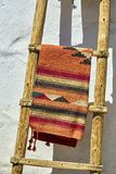 Handcrafted Mexican blanket and ladder. Traditional colors, textures and materials Royalty Free Stock Photography