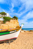 Traditional colourful fishing boat on beach Stock Photography