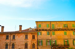 Traditional colourful houses on the bank of Adige River, Verona, Italy Stock Images