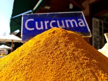 Traditional colourful spiecies in a typical exotic moroccan suk market. Curcuma turmeric writing stock image