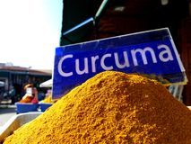 Traditional colourful spiecies in a typical exotic moroccan suk market. Curcuma turmeric writing stock photo