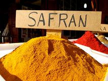 Traditional colourful spiecies in a typical exotic moroccan suk market. Saffron and Paprika writings royalty free stock image