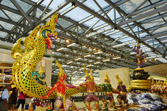 Traditional composition of sculptures inside Bangkok airport royalty free stock photo
