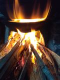 Traditional cooking. Cooking with wooden fire Stock Image