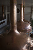 Traditional copper distillery tanks in a beer brewery Royalty Free Stock Images