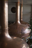 Traditional copper distillery tanks in a beer brewery Stock Photos