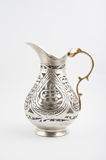 Traditional copper jug - ibrik. Traditional copper jug on white background royalty free stock image