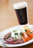 Traditional Corned Beef Dinner with Beer Royalty Free Stock Image