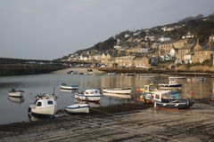 A traditional Cornish fishing village and harbor Stock Images