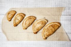 Traditional Cornish pasties. Five Cornish pasties of different sizes ranging fom cocktail to large royalty free stock images