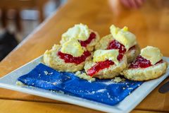 Traditional cornish pastries: scones with Strawberry Jam royalty free stock image