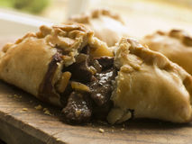 Traditional Cornish Pasty broken open. Close up of a Traditional Cornish Pasty broken open Royalty Free Stock Photo