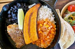 Traditional Costa Rican Casado. Meal with rice, beans and plantains royalty free stock photo
