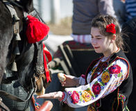 Traditional costume and horse. Image taken at the Tudorita festival in Targoviste, Romania. Tudorita or Pastele Cailor festival took place March 3. traditional Royalty Free Stock Photos