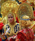 Traditional costume of west sumatra. Traditional costume for a lady in west sumatra, she is on parade, colourfull with crown on the head Royalty Free Stock Photos