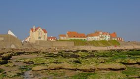 Typical houses on the of the North sea coast in Audreselles, France. Traditional cosy houses on the of the North sea coast with rock beach in Ambleteue, France royalty free stock image