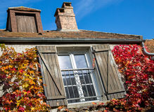 Traditional cottage in early Autumn Royalty Free Stock Photos