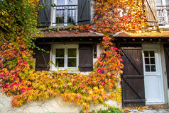 Traditional cottage in early Autumn Royalty Free Stock Images
