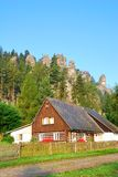 Traditional cottage with forest and sandstone towers Royalty Free Stock Images