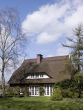 Traditional cottage with thatched roof. Lower Saxony, Northwest Germany Royalty Free Stock Photo