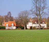 Traditional Cottages by an English Village Green Stock Images