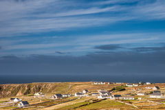 Traditional cottages on rugged coastline Stock Photography
