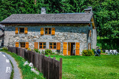 Traditional country house in switzerlands alps Stock Images