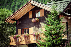 Traditional country house in switzerlands alps Stock Photos
