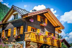 Traditional country house in switzerlands alps Stock Photography