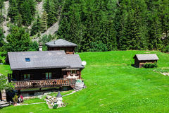 Traditional country house in switzerlands alps Stock Photo