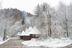 Traditional countryside house in winter. Winter rural road Royalty Free Stock Image
