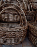 Traditional craft. Wicker baskets on wooden shelf detailed Royalty Free Stock Images