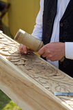 Traditional craftsman carving wood Stock Photos
