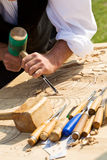 Traditional craftsman carving wood. With floral motifs Stock Photos