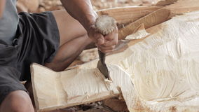 Traditional craftsman carving wood an elephant. Stock Image