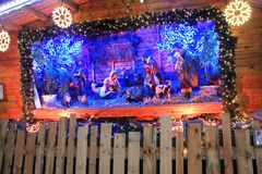 Traditional creche at the Christmas Market in Luxembourg. Traditional Christmas Market in Luxembourg Ville. Wooden crèche with Jesus and saints Royalty Free Stock Image