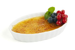 Traditional creme brulee with berry fruit Royalty Free Stock Images