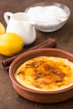 Traditional creme brulee on ceramic dish Stock Image