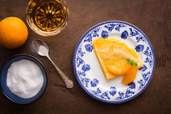 Traditional crepe suzette on wooden table Stock Photo