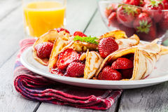 Traditional crepes served with strawberries Stock Images