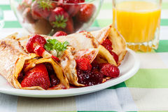 Traditional crepes served with strawberries Royalty Free Stock Images