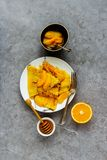 Traditional Crepes Suzette. Crepes Suzette on plate. Flat lay of thin pancakes with orange sauce over grey concrete table background. Top view - Image stock images