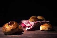 Traditional brioches on wooden table. Stock Photography