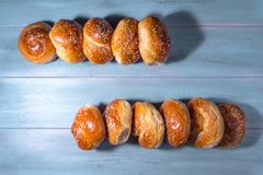 Traditional brioches on wooden table. Traditional cretan brioches on wooden table Stock Photo