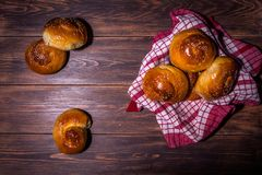 Traditional brioches on wooden table. Traditional cretan brioches on wooden table Stock Images