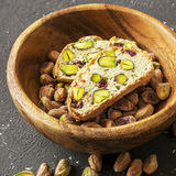 Traditional crispy Italian biscotti or cantuchini crackers with pistachios and dried cranberries in a bowl of olve wood Stock Images