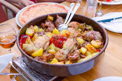Traditional croatian food peka with mix meat and vegetables. Traditional croatian food peka with mix meat, vegetables and wine stock image